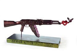 Make Love Not War ( Purple) by Dan Pearce - Original Sculpture sized 34x9 inches. Available from Whitewall Galleries